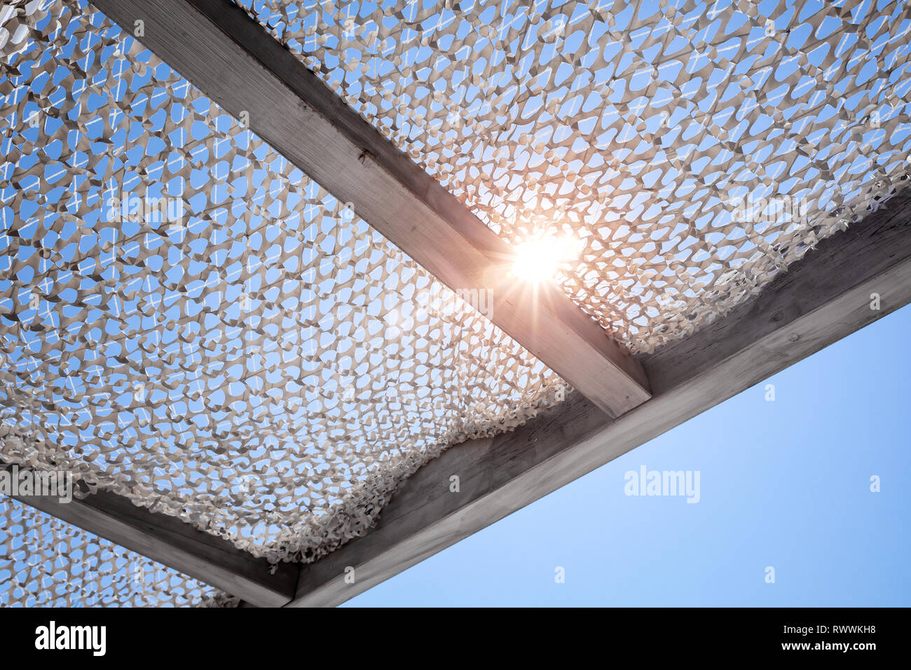 Sun canopy under blue sky with shining sun Stock Photo