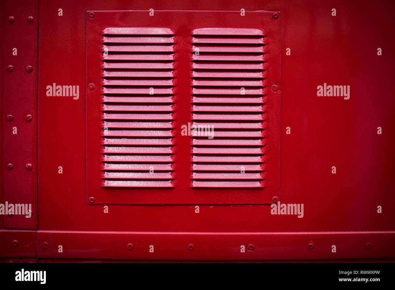 Color image of the air vents of a vintage red bus Stock