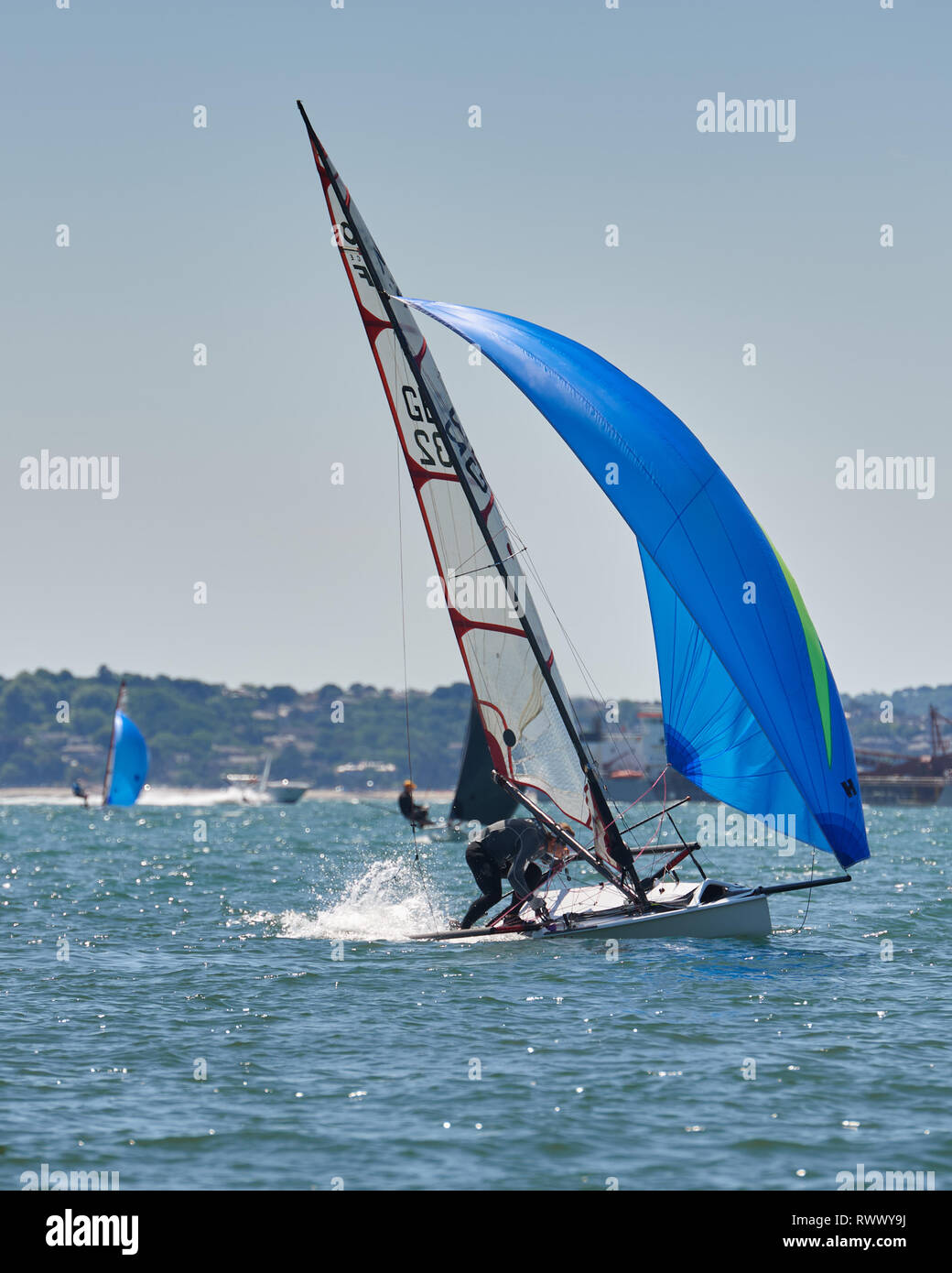 Performance. Musto Skiff racing making a jibe. An exhilaration sport. - Stock Image