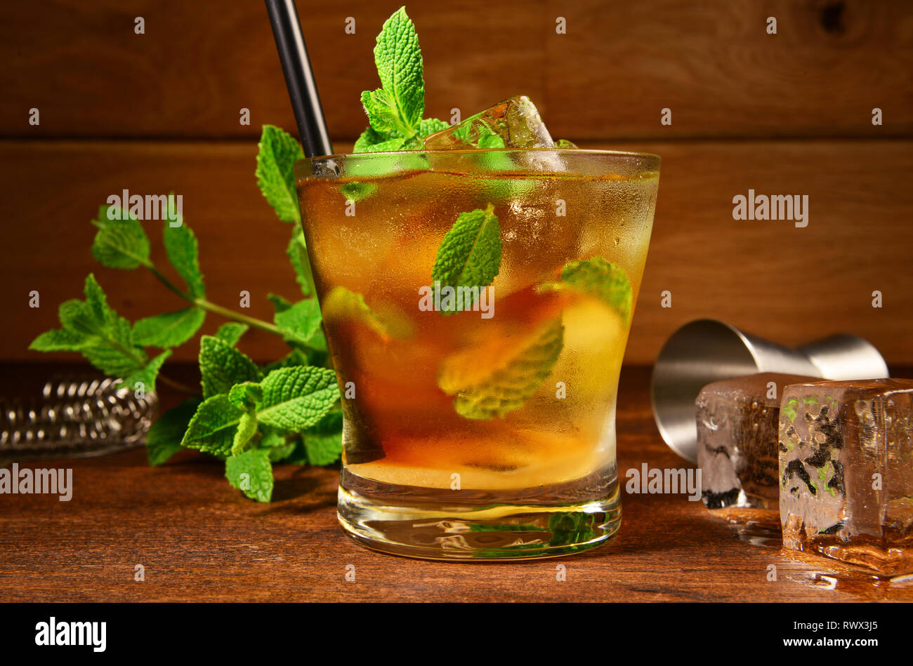 Mint Whisky Cocktail on wooden Background - Stock Image
