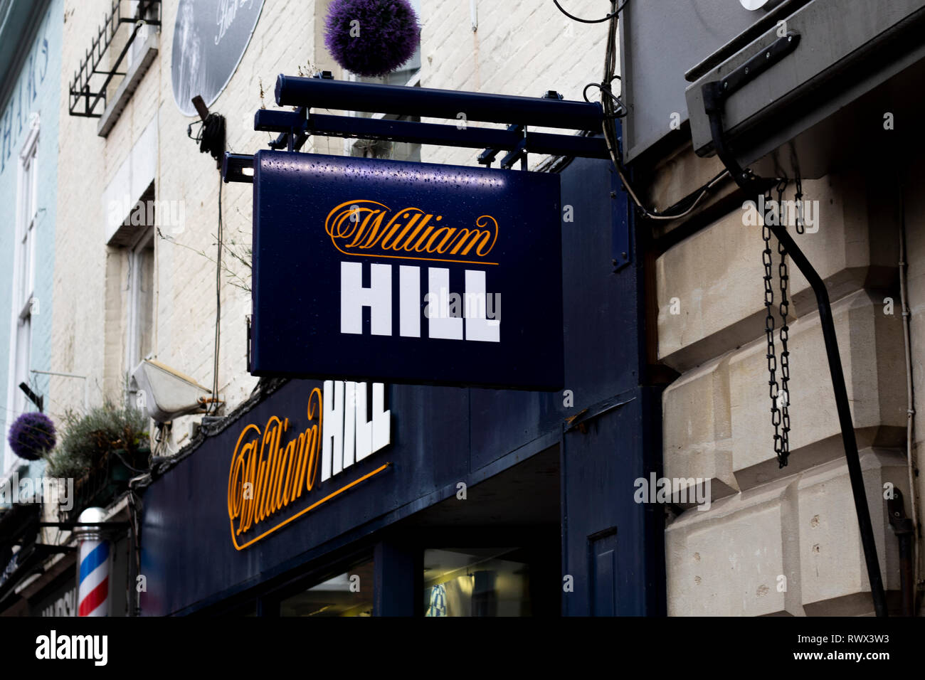 William Hill bookmakers sign, company founded by William Hill in 1934 at a time when gambling was illegal in Britain Stock Photo