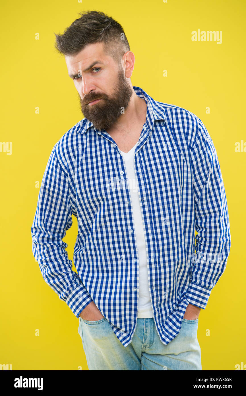 Having some doubts. Beard fashion and barber concept. Man bearded hipster beard yellow background. Barber tips maintain beard. Stylish beard mustache care. Emotional expression. Hipster appearance. - Stock Image