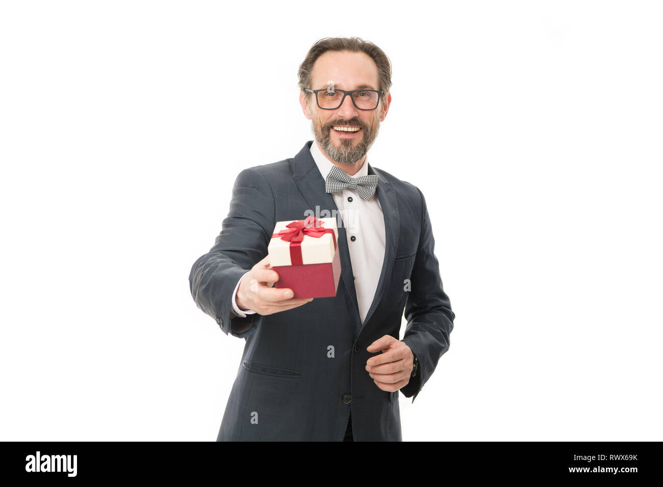 Attentive man. Gift for spouse. Romantic surprise. Man formal suit hold gift box white background. Love and romantic feelings concept. Valentines day gift. Man with beard celebrate valentines day. - Stock Image