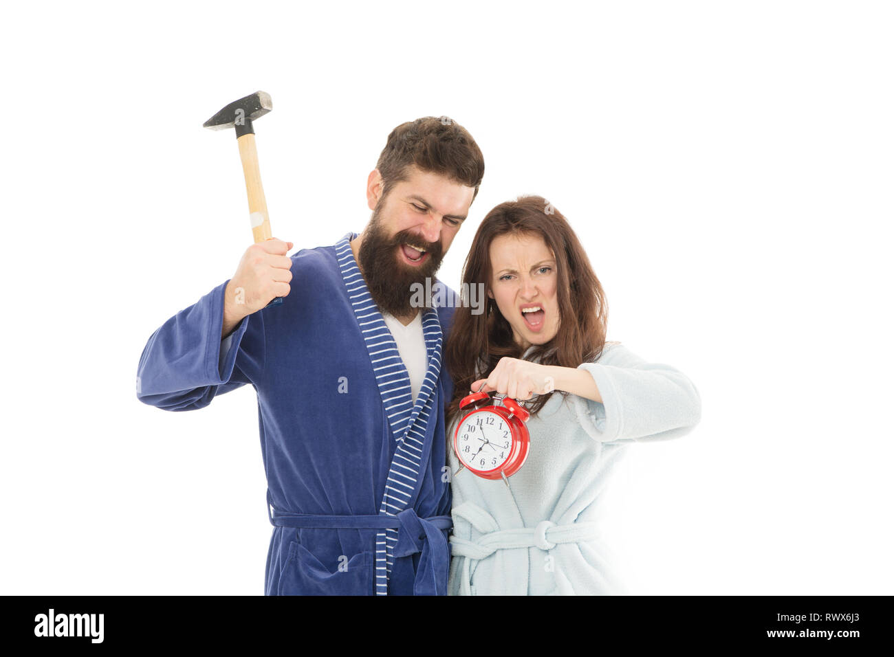 I hate monday. Couple morning awakening alarm clock. We should go to bed earlier. stressed bearded man and woman. Crush the rush. Hate morning awakening. hate morning alarms everyday. lack of sleep. - Stock Image