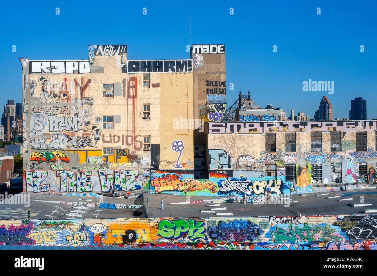 Near the PS1 and Graffiti lovers, there are ships that can be painted from the underground line 7 to show the full fury of this art. PS1 (MOMA). - Stock Image