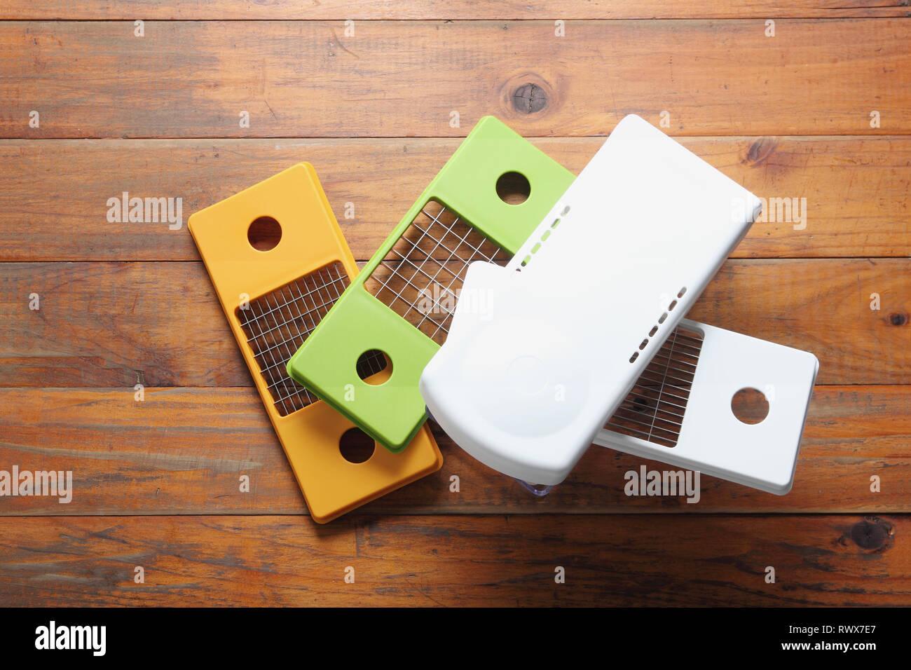 Vegetable Slicer on Wooden Background Stock Photo