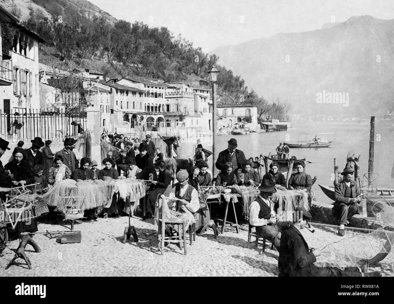 working fishing nets, lago d'iseo, lombardy, italy 1940 - Stock Image