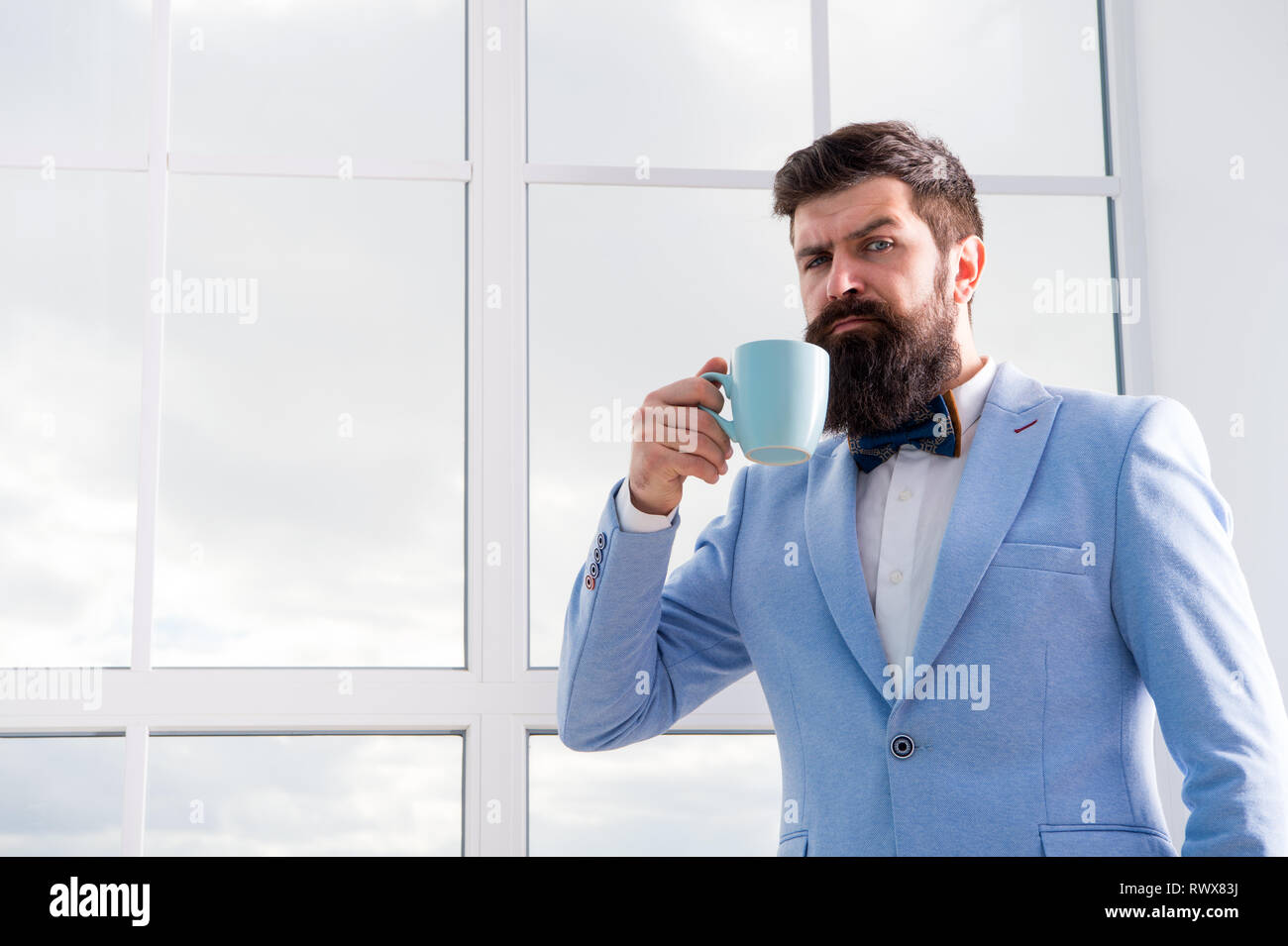 future opportunities. serious bearded man drink coffee. businessman in formal outfit. modern life. confident business man at window. future success. morning inspiration. copy space. Future is now. Stock Photo