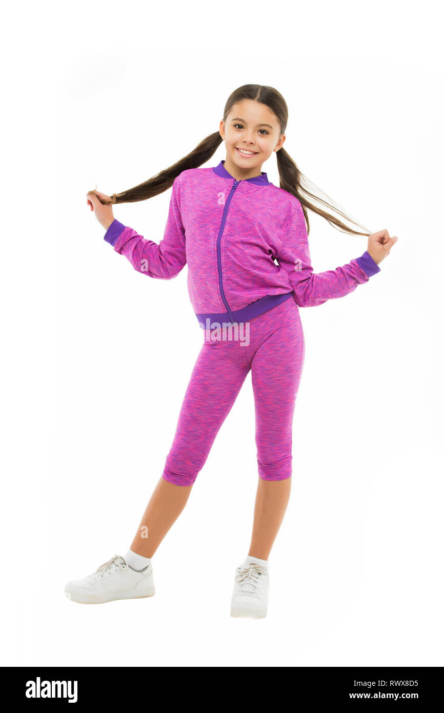 Working out with long hair. Girl cute kid with ponytails wear sport costume isolated on white. Stay comfortable with long hair during sport classes. Deal with long hair while sport exercising. - Stock Image