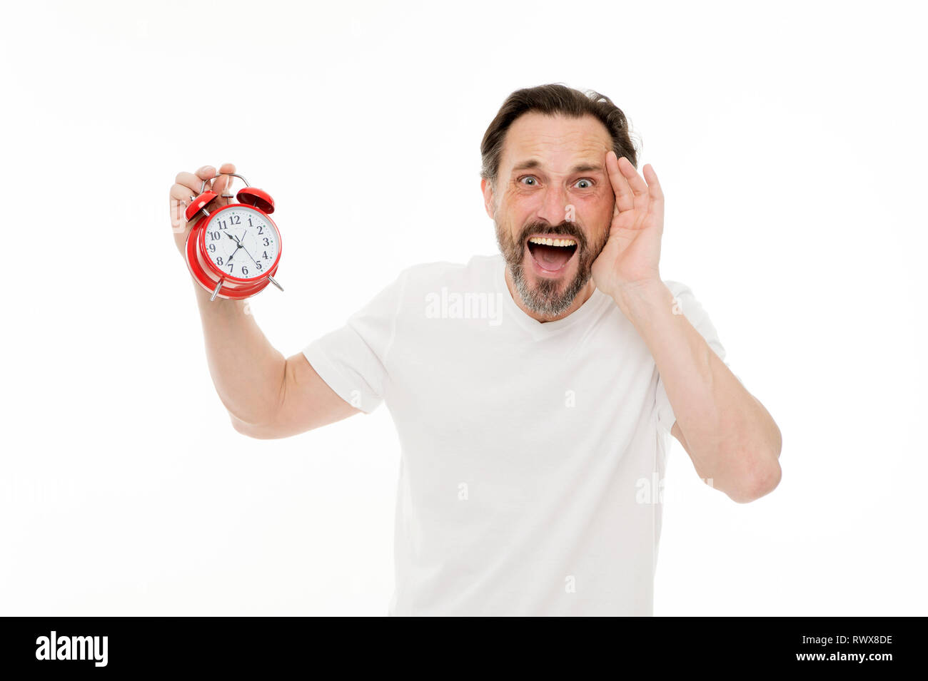 Stressful times. Man bearded mature guy hold clock isolated on white. Man with beard check what time is it. Time management skills. Personal schedule and daily regime. Alarm clock morning time. - Stock Image