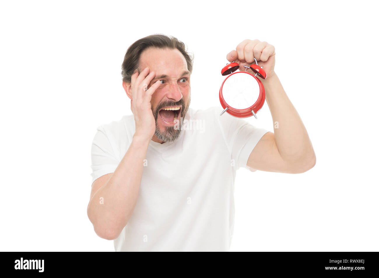Guy bearded mature man worry about time left till work. Time management and discipline. Punctuality and responsibility. Man with clock on white background. Monday again. Man hold alarm clock in hand. - Stock Image