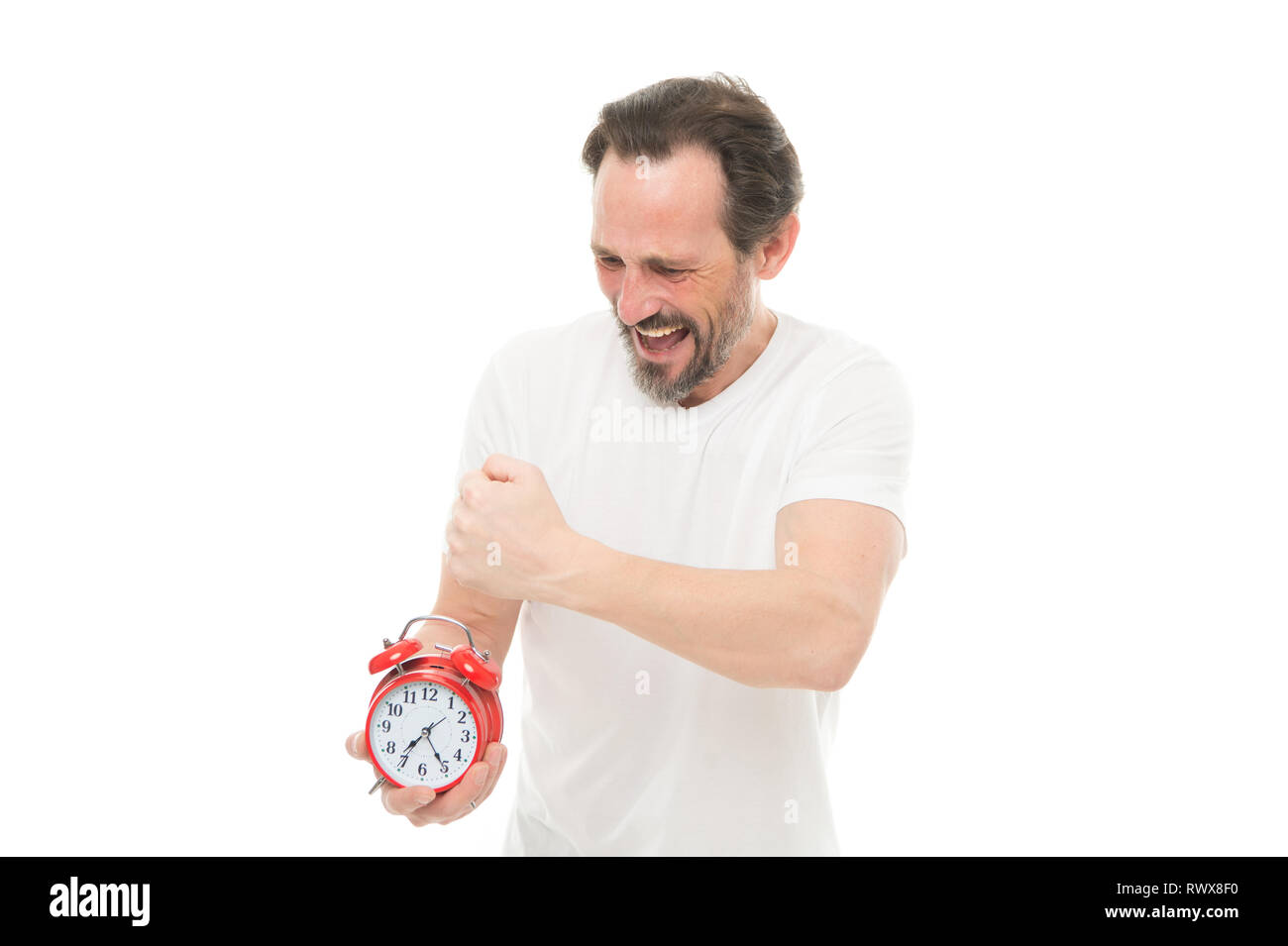 Time management and discipline. Punctuality and responsibility. Man with clock on white background. Suffer from regime. Man hold alarm clock in hand. Guy bearded mature man worry about time left. - Stock Image
