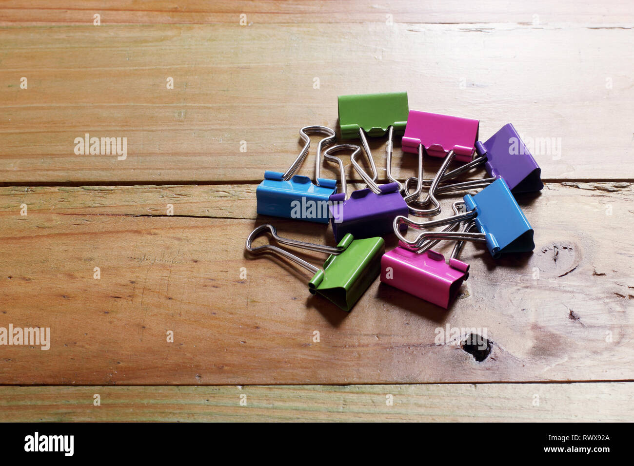 Paperclips on Wooden Background - Stock Image