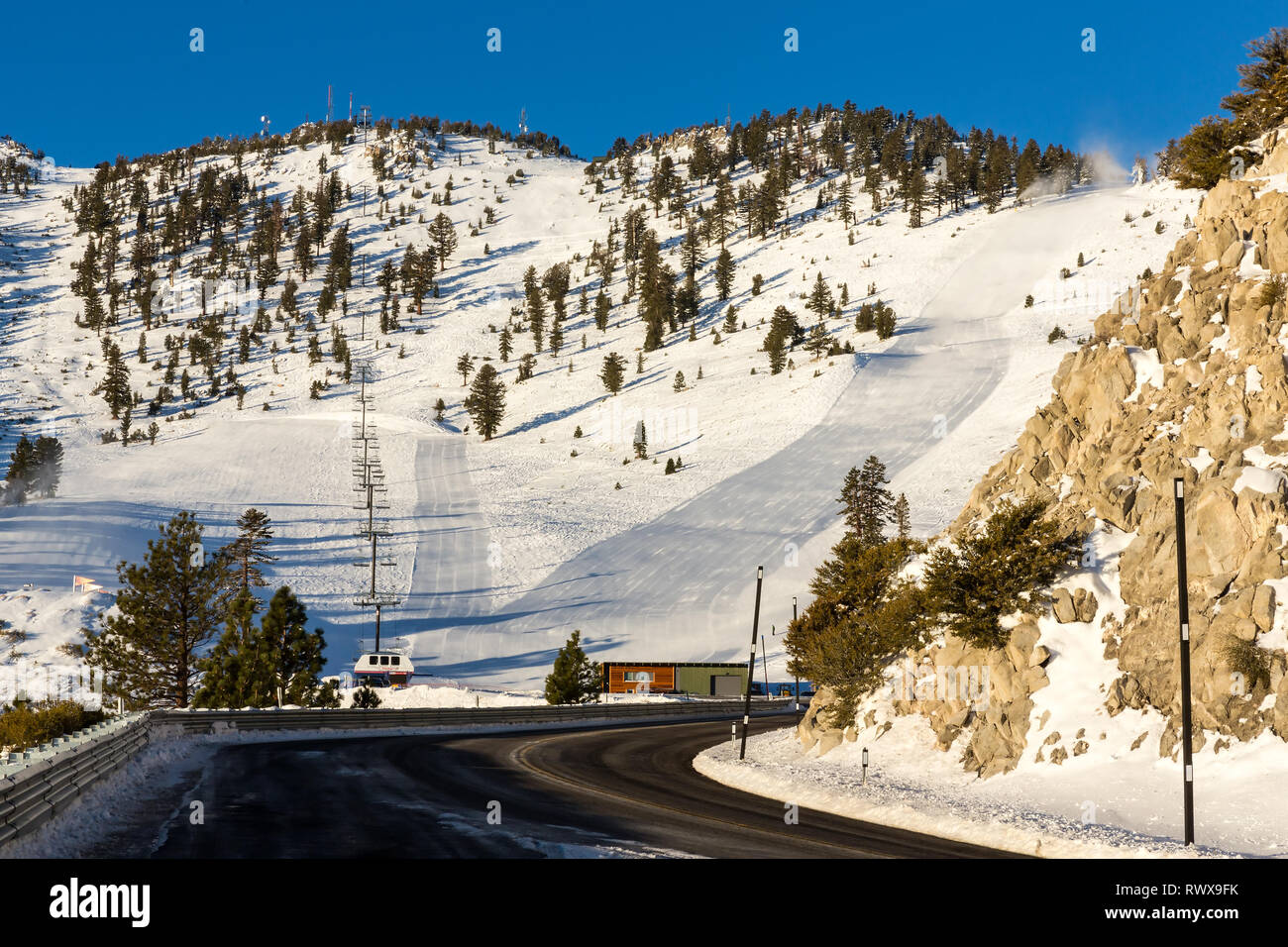 Ski resort in the winter with groomed runs going up the hill Stock Photo