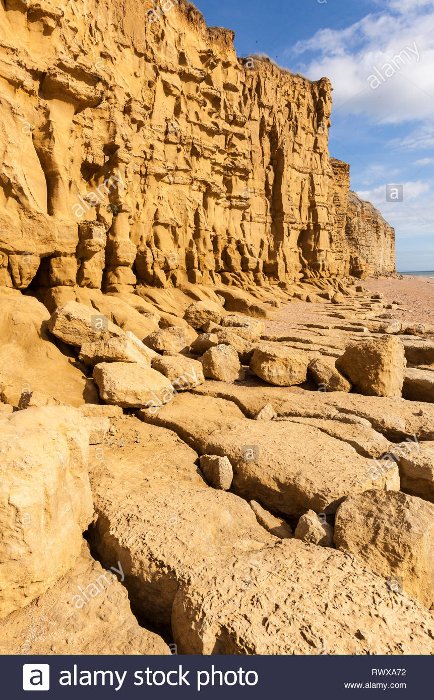 Eroded Burton Cliff. The sandstone cliffs were laid down in the Jurassic and are a popular tourist attraction. The cliffs are prone to collap - Stock Image