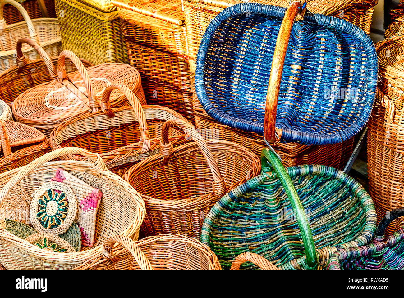 Shopping for wicker baskets at a German weekly market - Stock Image