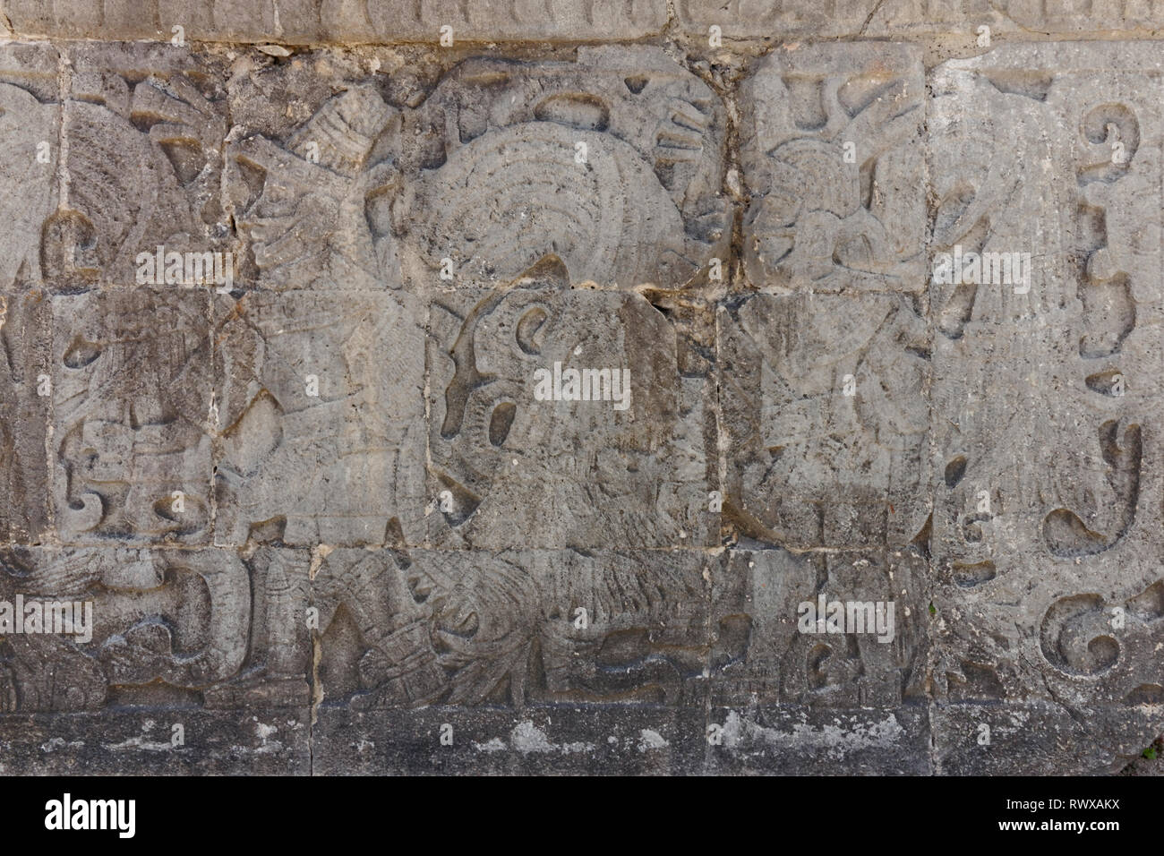 Close up of a Mayan carved stone panel in Chechen Itza possibly depicting a King. - Stock Image
