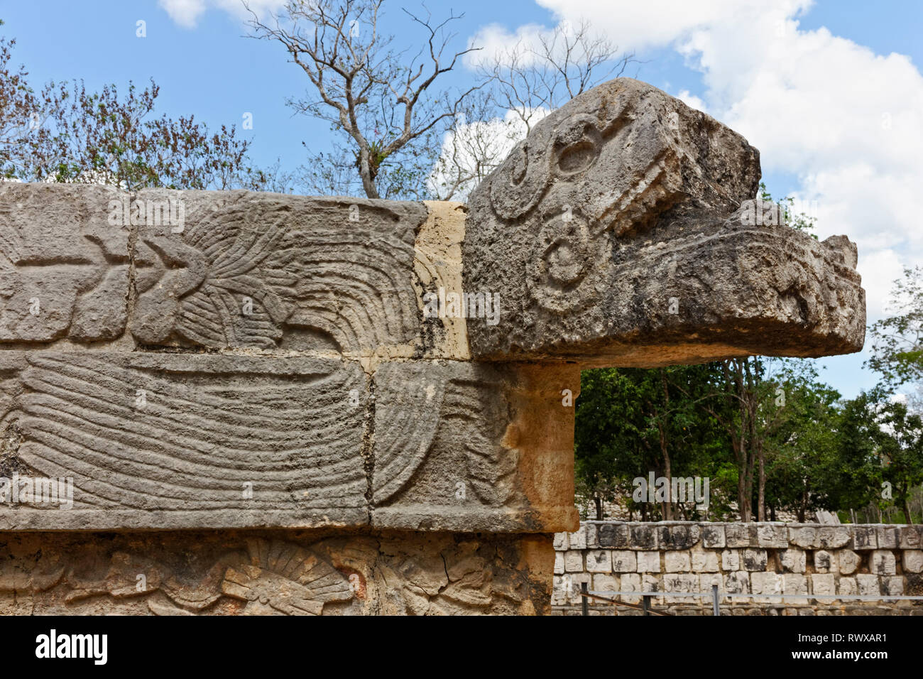 The head of Mayan carved stone snake with geometric ornamentation on its body from Chechen Itza - Stock Image