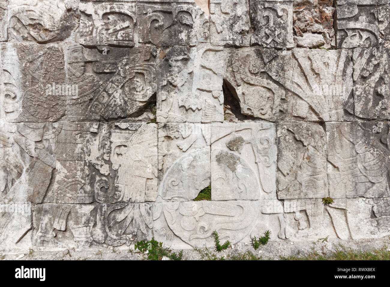 Close up of a large Mayan stone carving depicting soldiers, royalty and possibly a King, from the Mayan city of Chechen Itza - Stock Image