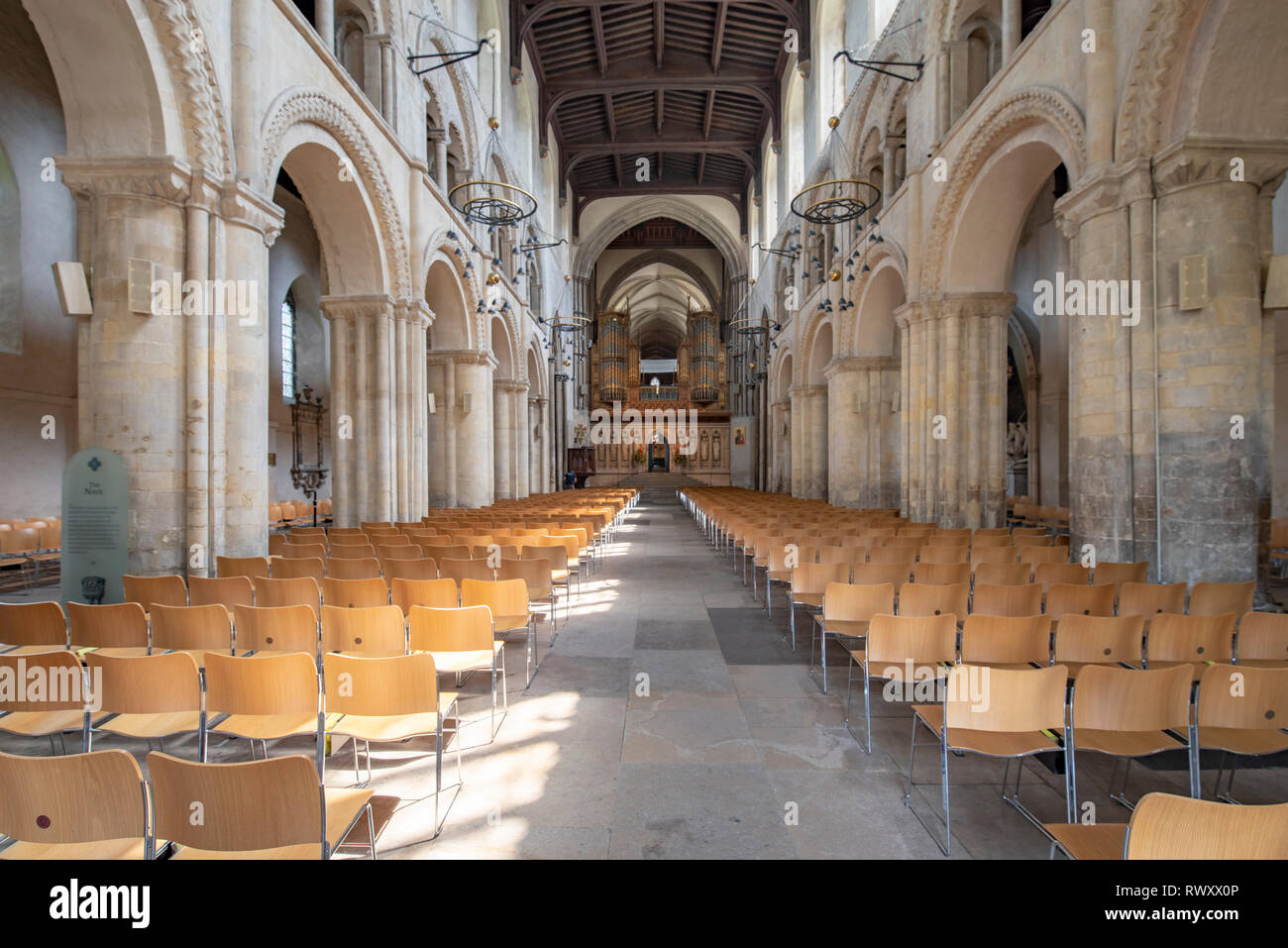 Interior views of the Cathedral in Rochester on  a sunny day with light flooding in and casting shadows. the pipe organ, nave and Transepts and tomb - Stock Image