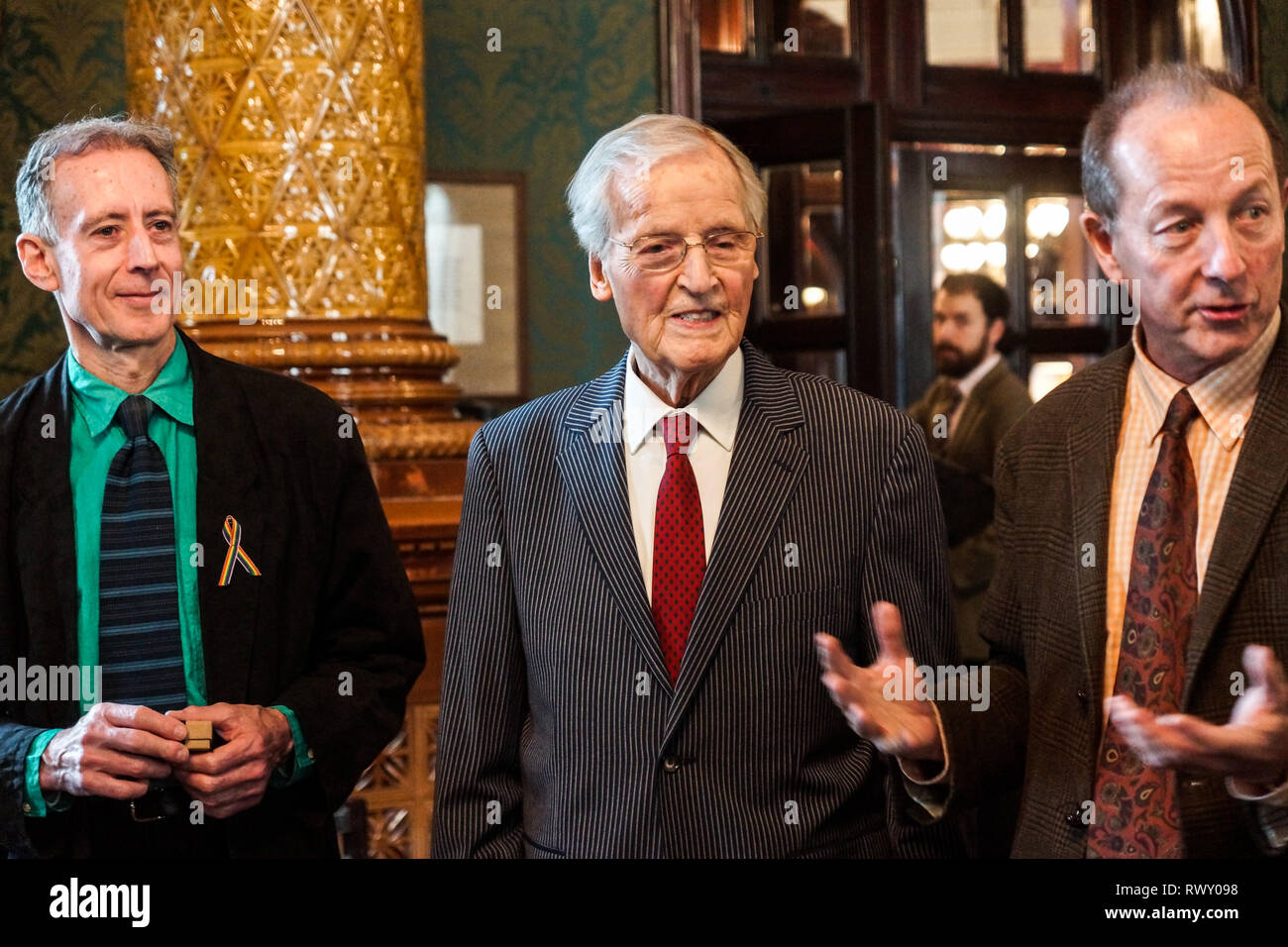 London, UK. 07th Mar, 2019. Peter Tatchell, Nicholas Parsons, Rupert MorrisNicholas Parsons, actor and host of long-running Just a Minute, Peter Tatchell, human rights activist, and Valerie Brandes, founder and publisher of Jacaranda Books accept Honorary Membership of the National Liberal Club at a luncheon hosted by NLC Chairman, Rupert Morriss. Credit: Peter Hogan/Alamy Live News - Stock Image