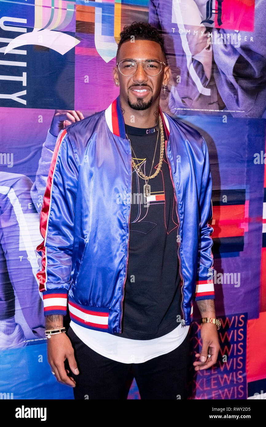 Berlin, Germany. 07th Mar, 2019. Jerome Boateng, football player, stands in front of a photo wall at the Tommy Hilfiger CREATExUNITY event. Credit: Christoph Soeder/dpa/Alamy Live News - Stock Image