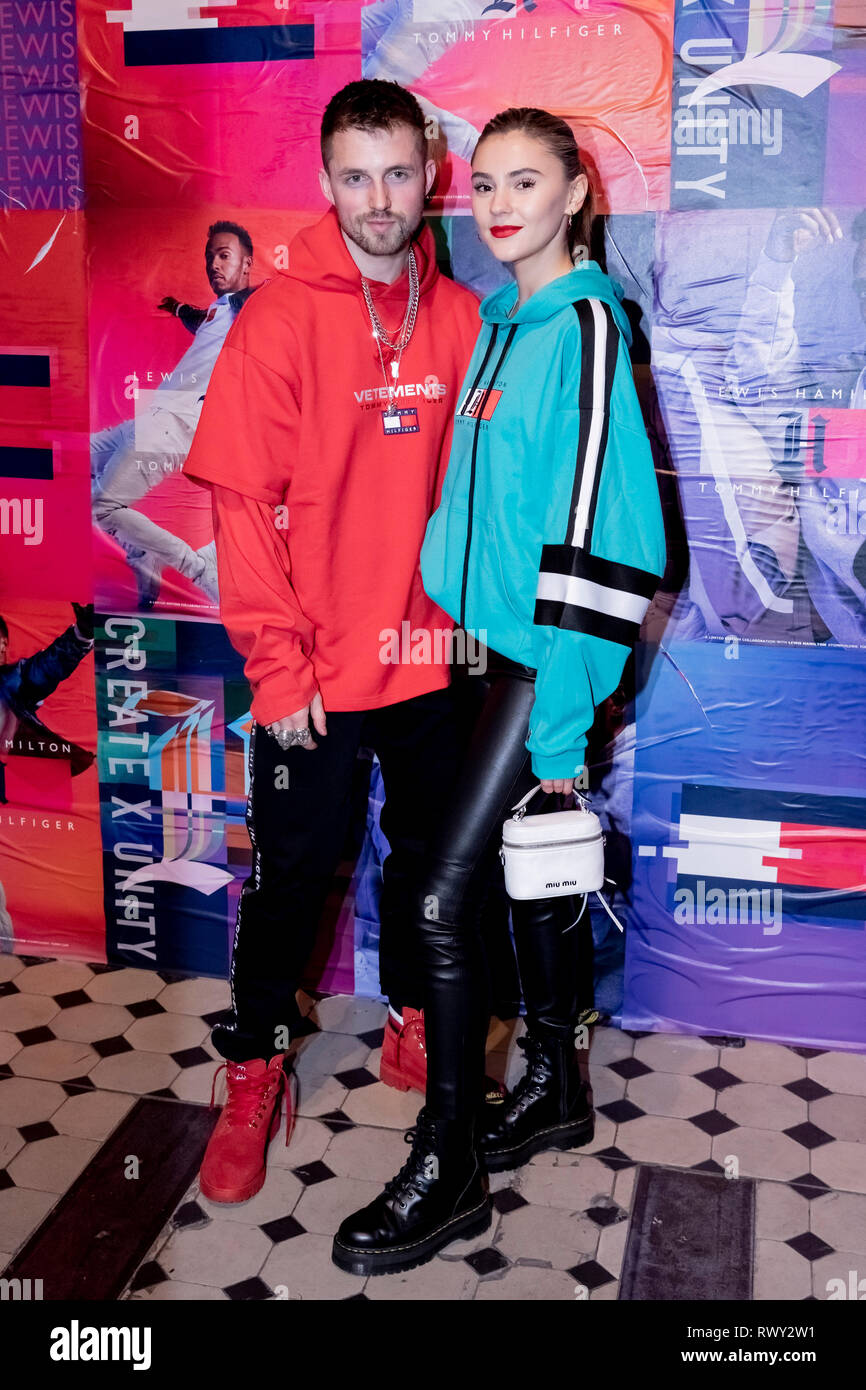 Berlin, Germany. 07th Mar, 2019. Marcus Butler, influencer, and Stefanie Giesinger, model, stand in front of a photo wall at the Tommy Hilfiger CREATExUNITY event. Credit: Christoph Soeder/dpa/Alamy Live News - Stock Image