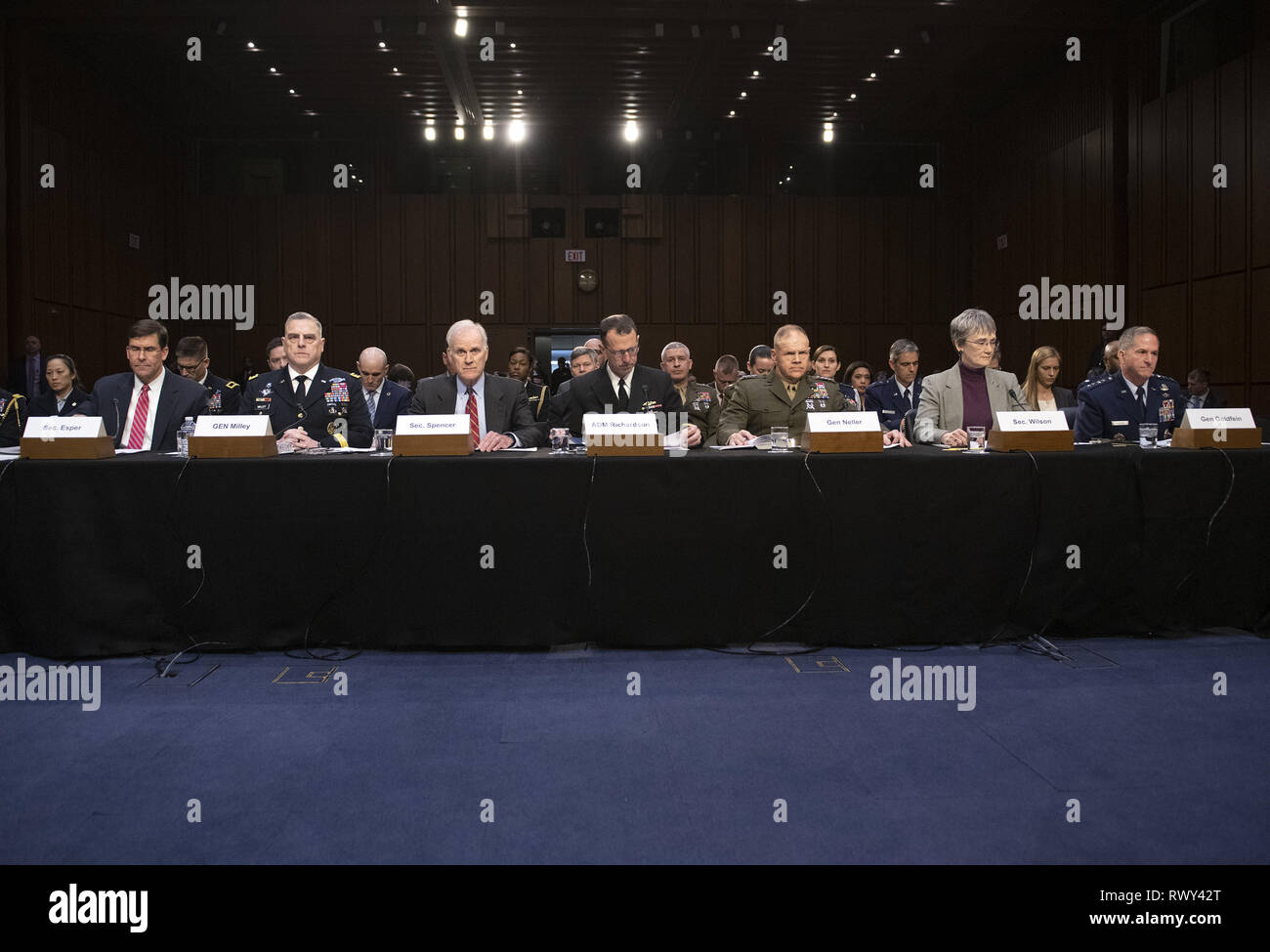 March 7, 2019 - Washington, District of Columbia, U.S. - From left to right: United States Secretary of the Army Dr. Mark T. Esper; US Army General Mark A. Milley, Chief of Staff of the Army; US Secretary of the Navy Richard V. Spencer; US Navy Admiral John M. Richardson, Chief of Naval Operations; US Marine Corps General Robert B. Neller, Commandant of the Marine Corps; US Secretary of the Air Force Heather Wilson; and US Air Force General David L. Goldfein, Chief of Staff of the Air Force testify before the US Senate Committee on Armed Services during a hearing on ''Chain of Command's Acco Stock Photo