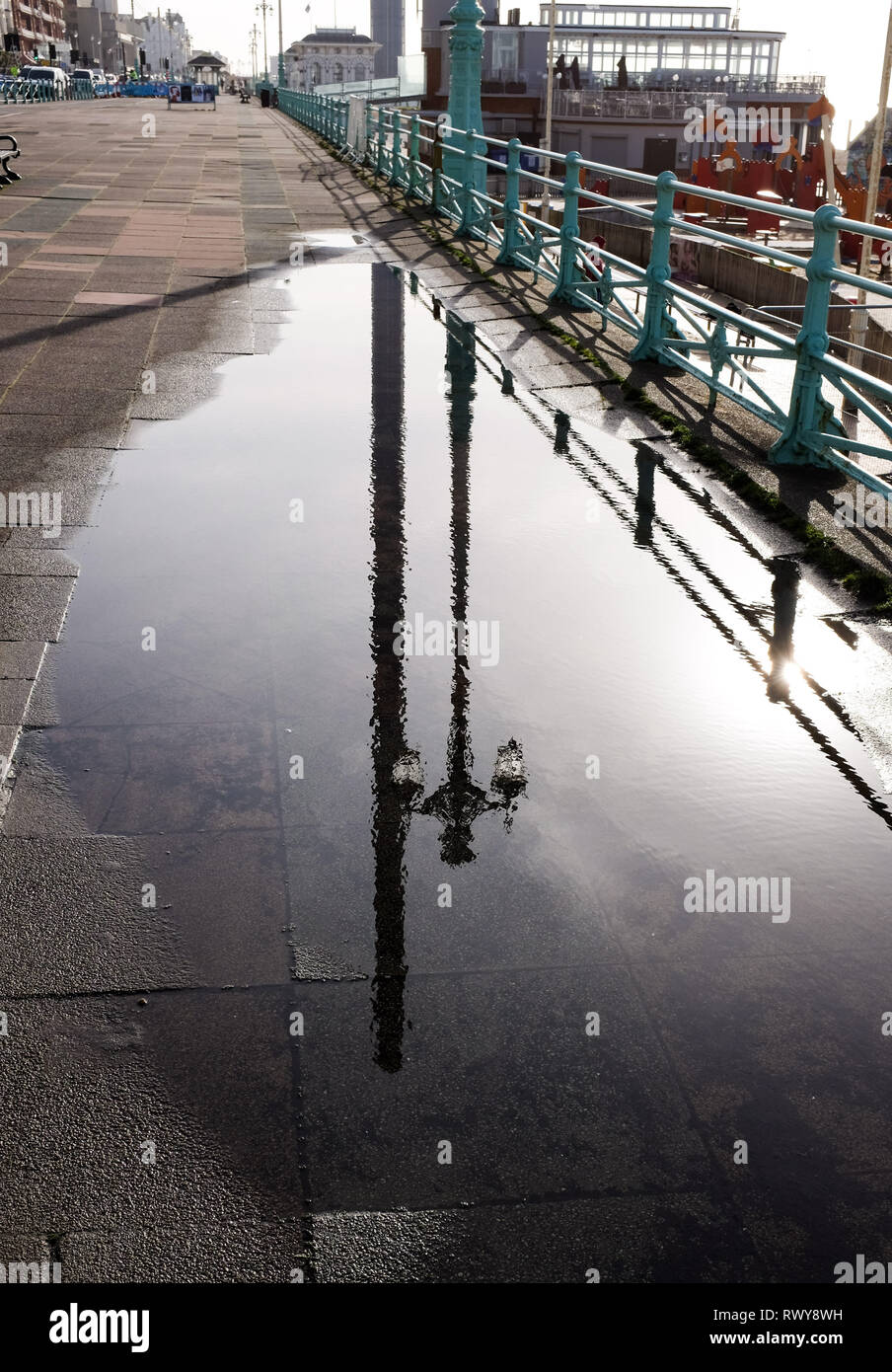 Brighton, UK. 8th Mar, 2019. Brighton seafront is reflected in a puddle on a beautiful sunny morning after heavy showers the previous day Credit: Simon Dack/Alamy Live News - Stock Image