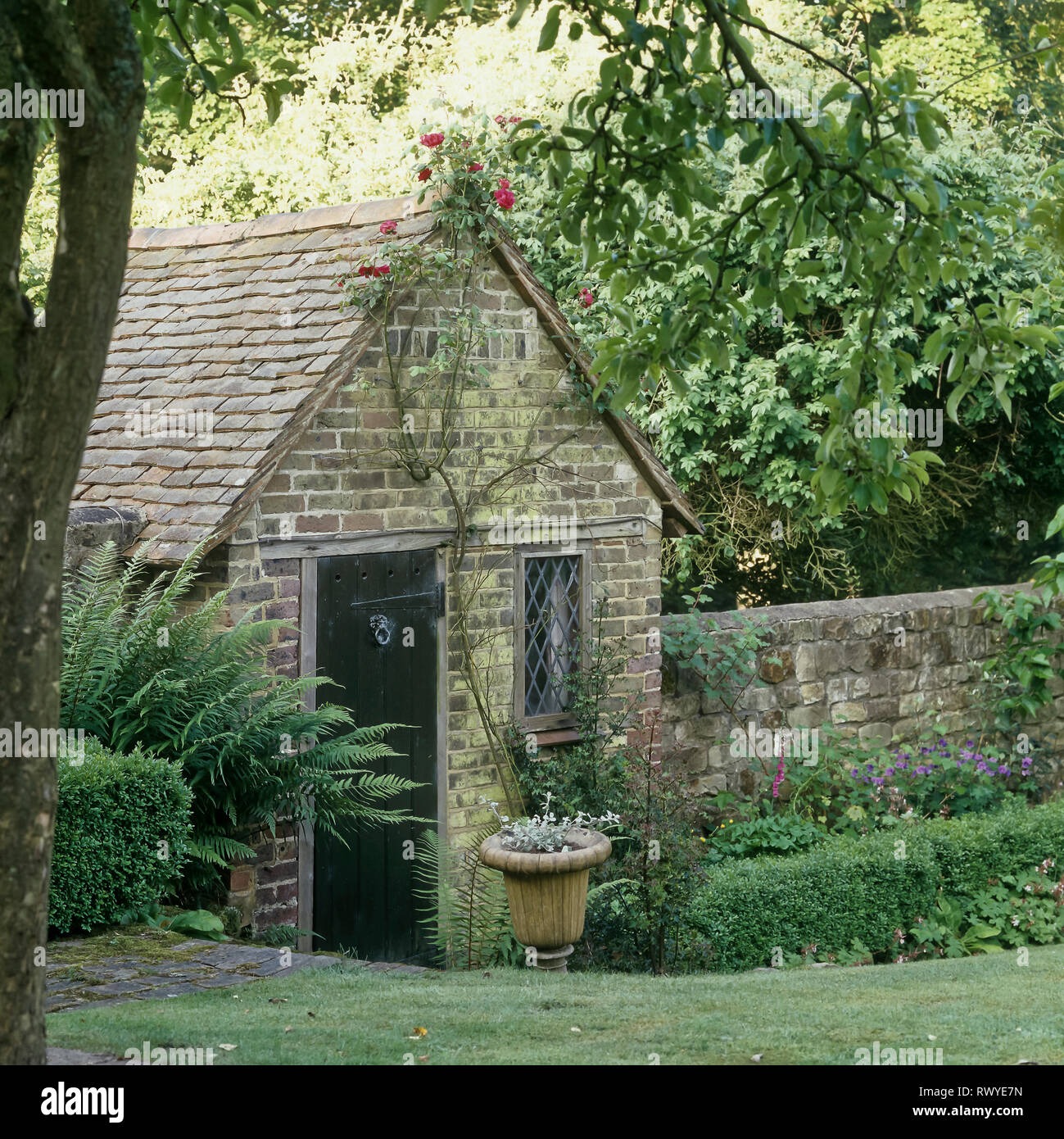 Brick shed in garden - Stock Image