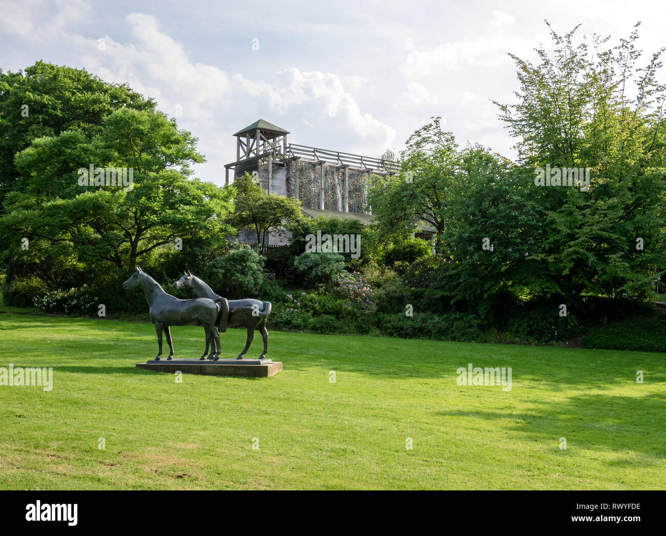 Sculpture of horses (Pferde) by Philipp Harth and graduation tower in the Gruga Park in Essen, Germany - Stock Image