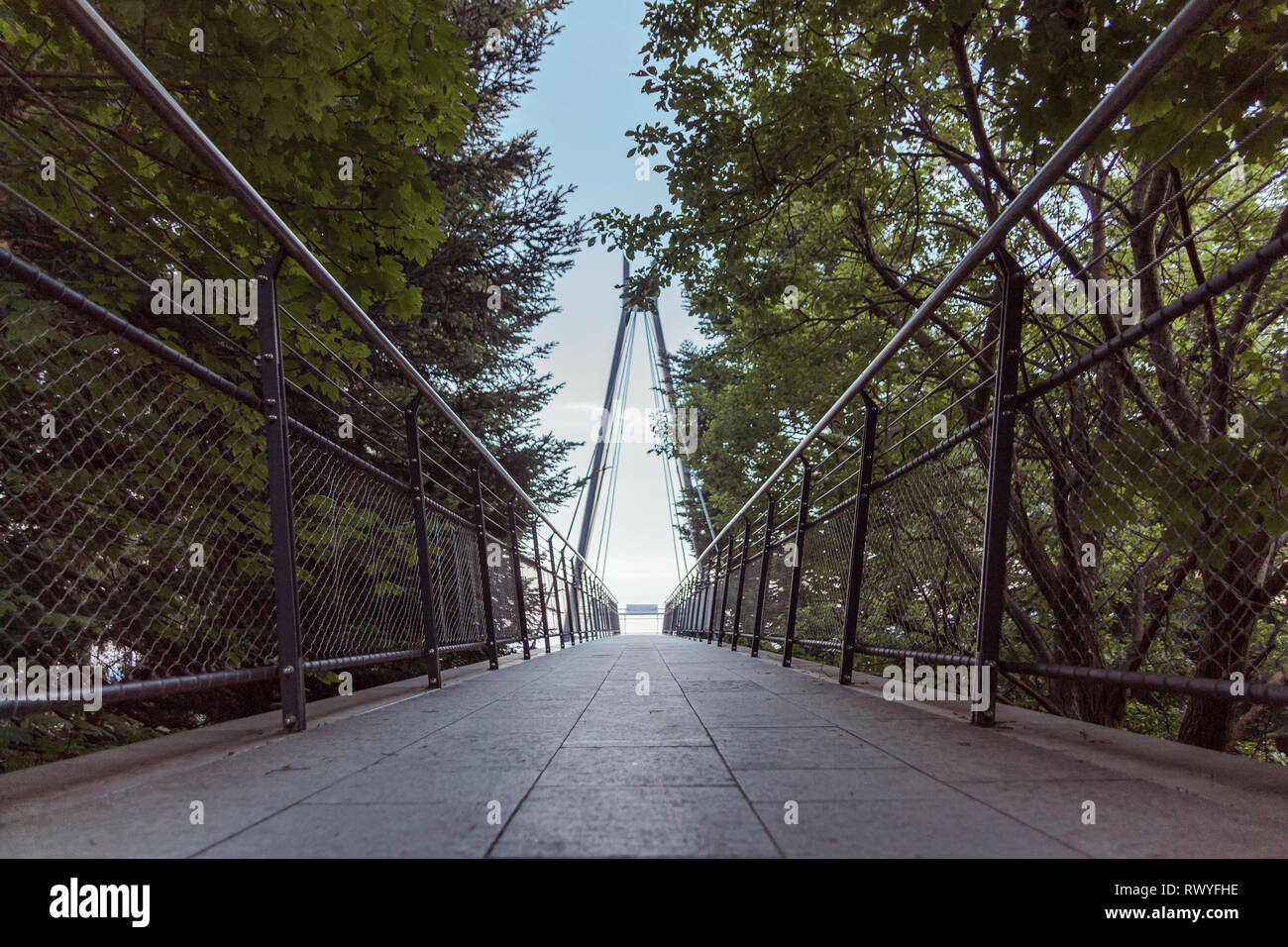 architectural and symmetric bridge in the mountains - Stock Image