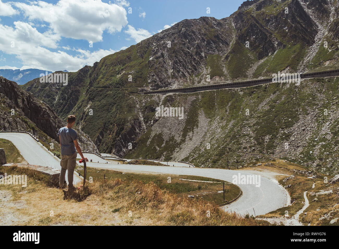 tremola road in san gottardo during a sunny day with a boy and his skateboard - Stock Image