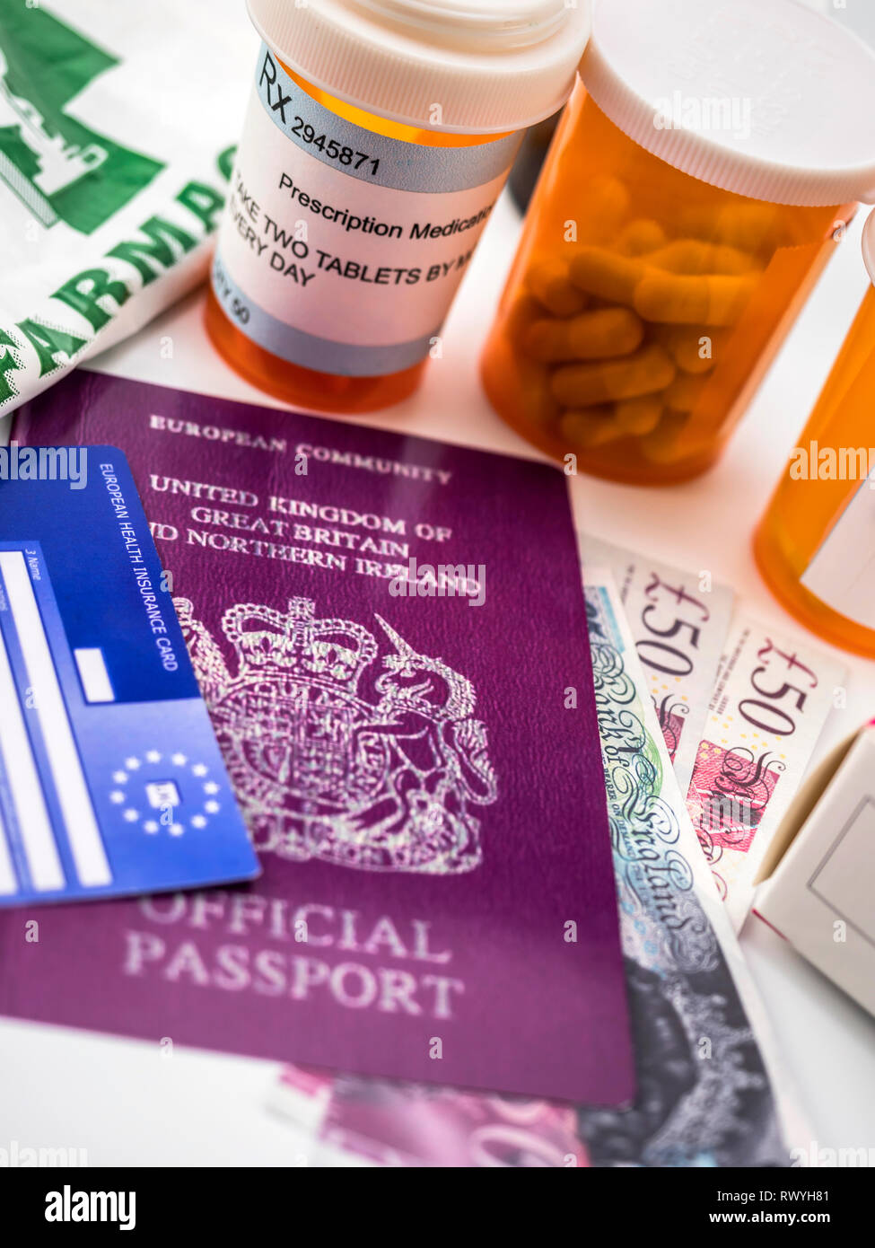 British passport and European health card along with several capsules, concept of medical price in the crisis of Brexit, conceptual image, vertical co - Stock Image