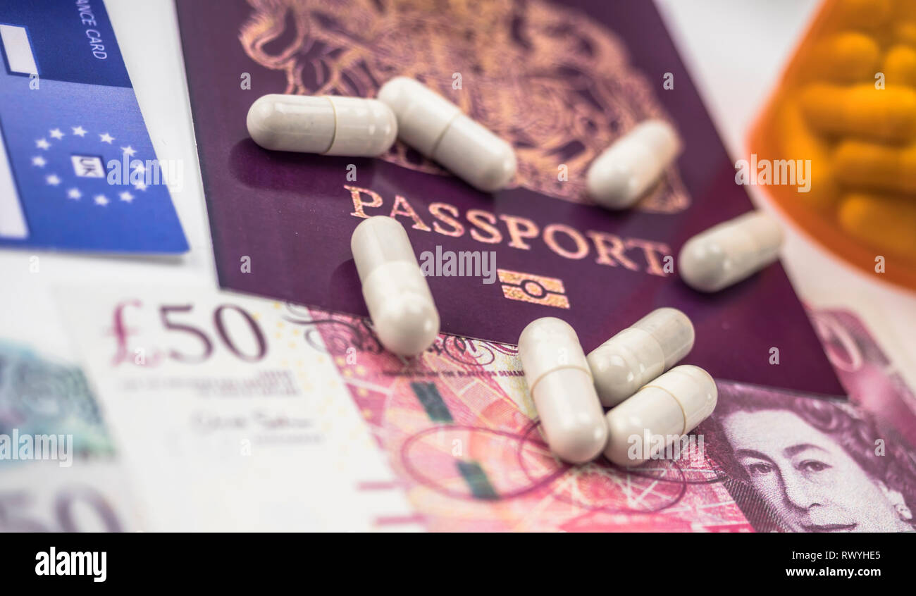 British passport and European health insurance card along with several capsules, concept of medical increase in the crisis of the brexit, conceptual i - Stock Image