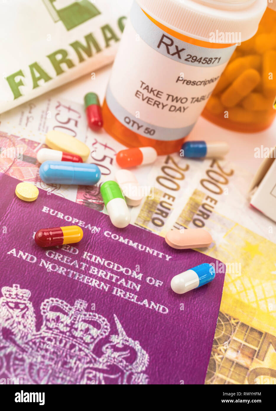 British passport along with several bottles of medicines, concept of medical increase in the crisis of the brexit, conceptual image, horizontal compos - Stock Image