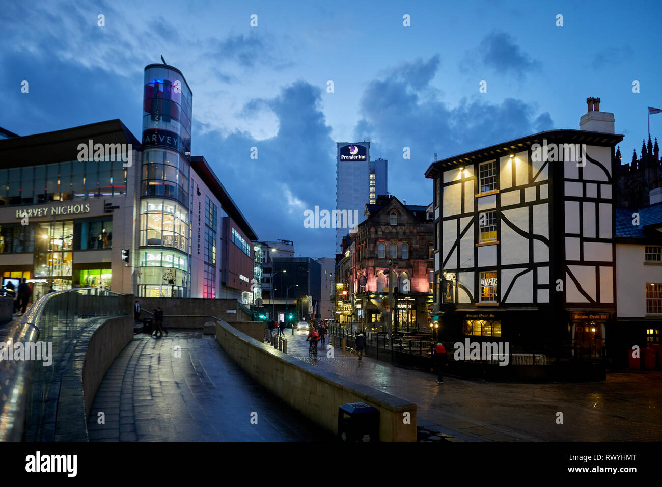 Designer department store Harvey Nichols and rebuilt Old Wellington Inn and Sinclair's Oyster Bar at Exchange Square, Shambles Square,  Manchester cit Stock Photo