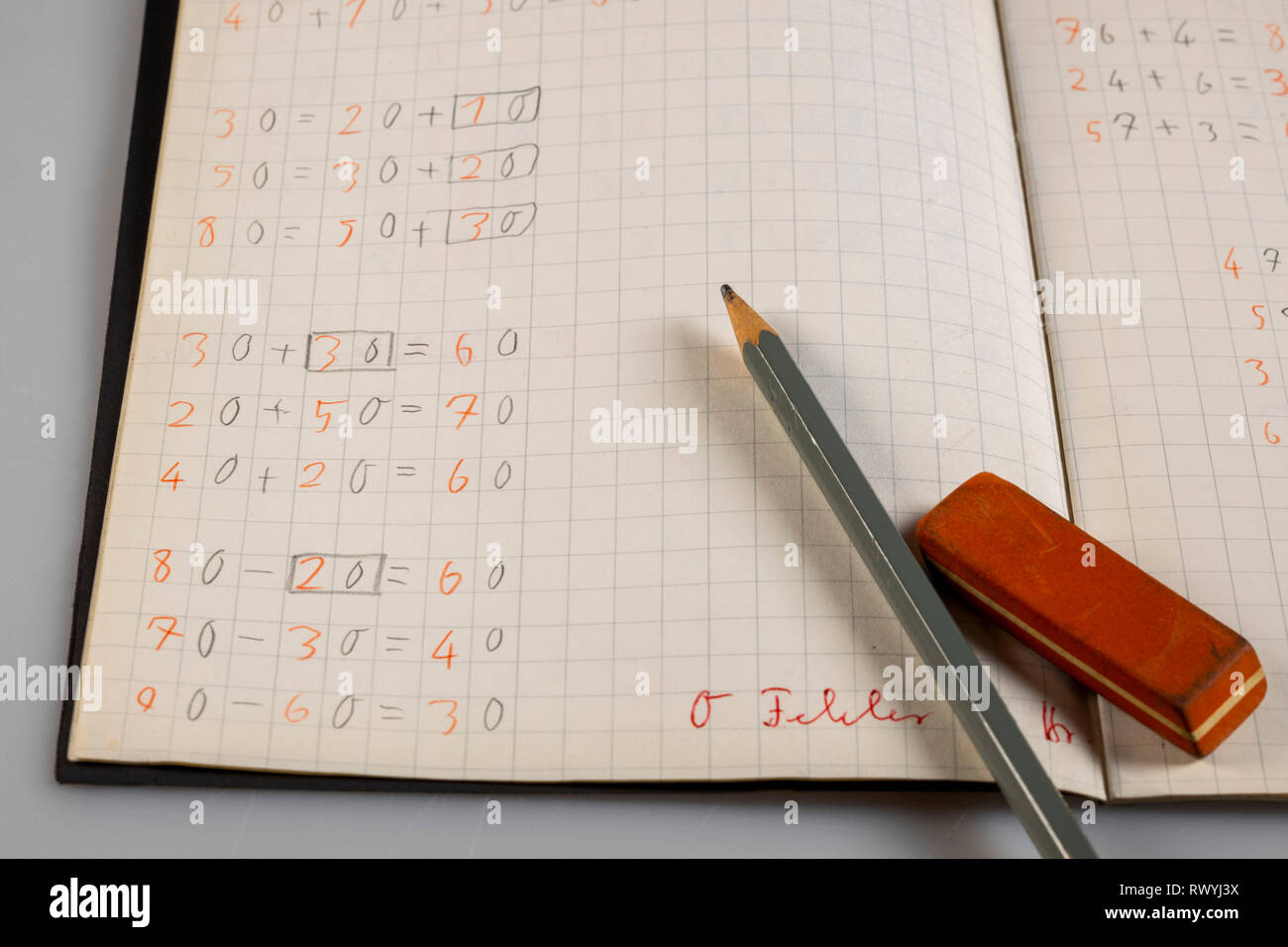 Exercise book, elementary school, arithmetical problems, mathematics, basic operations, correction, - Stock Image