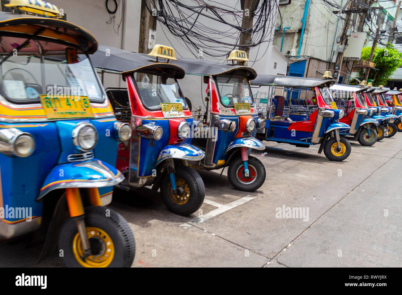 Typical transport in Thailand for tourists and people of the country. They are usually very colorful - Stock Image