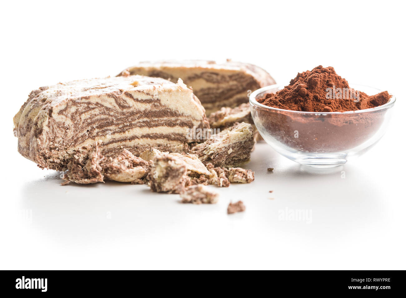 Sweet halva dessert slices with cocoa isolated on white background. - Stock Image