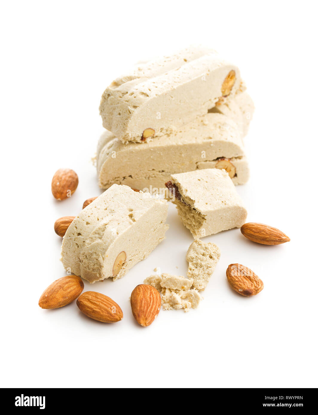 Sweet halva dessert slices with almonds isolated on white background.. - Stock Image