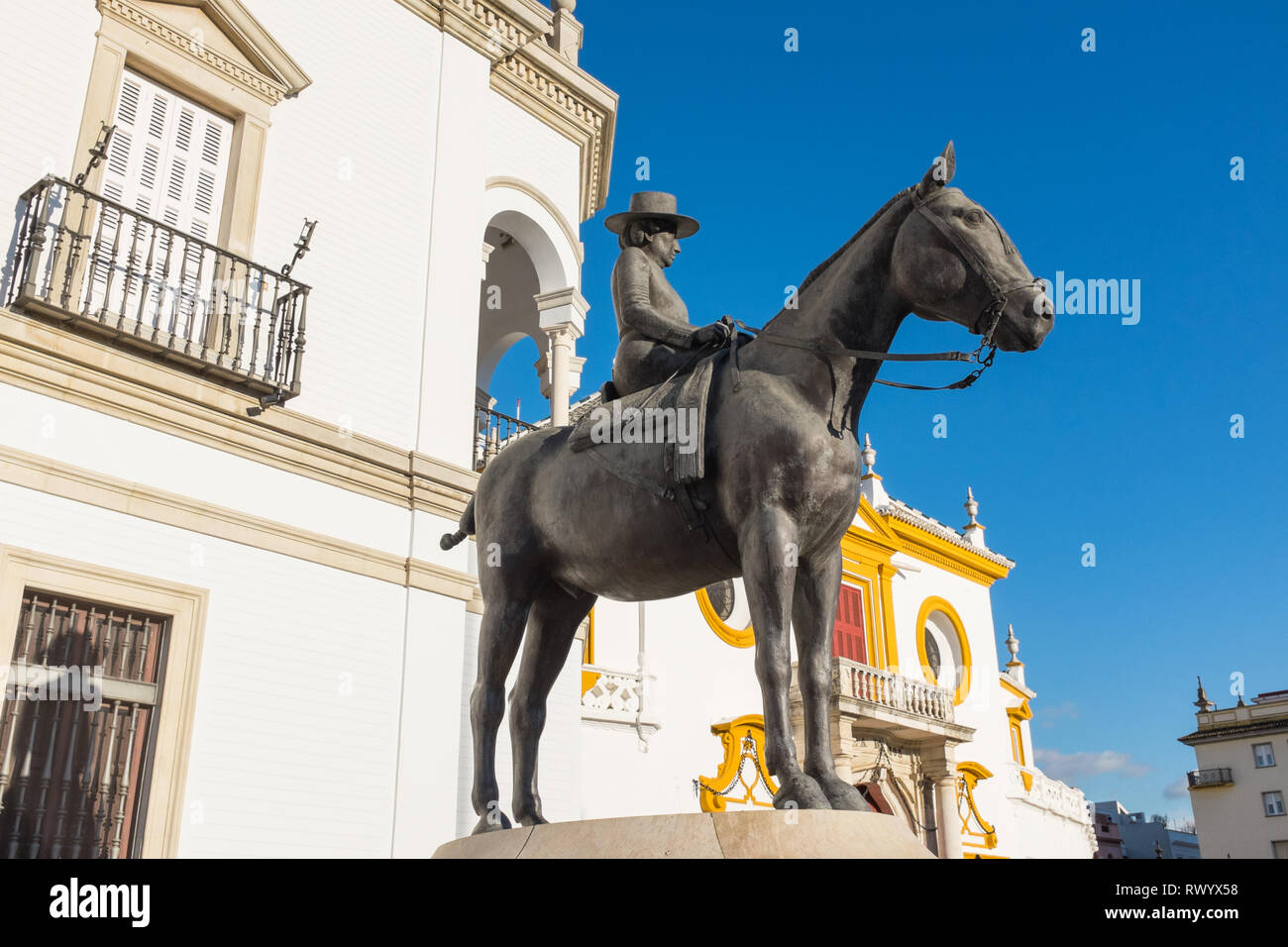 Statue outside Plaza de toros de la real maestranza de caballería de Sevilla or Seville Bullring arena - Stock Image