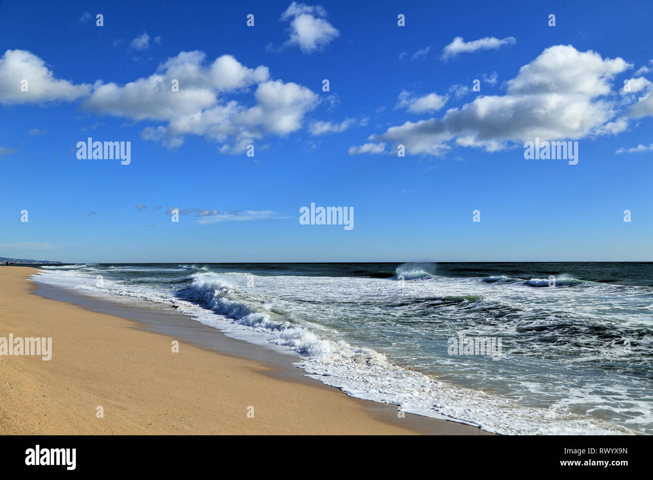 Beach, waves, blue sky and clouds. - Stock Image