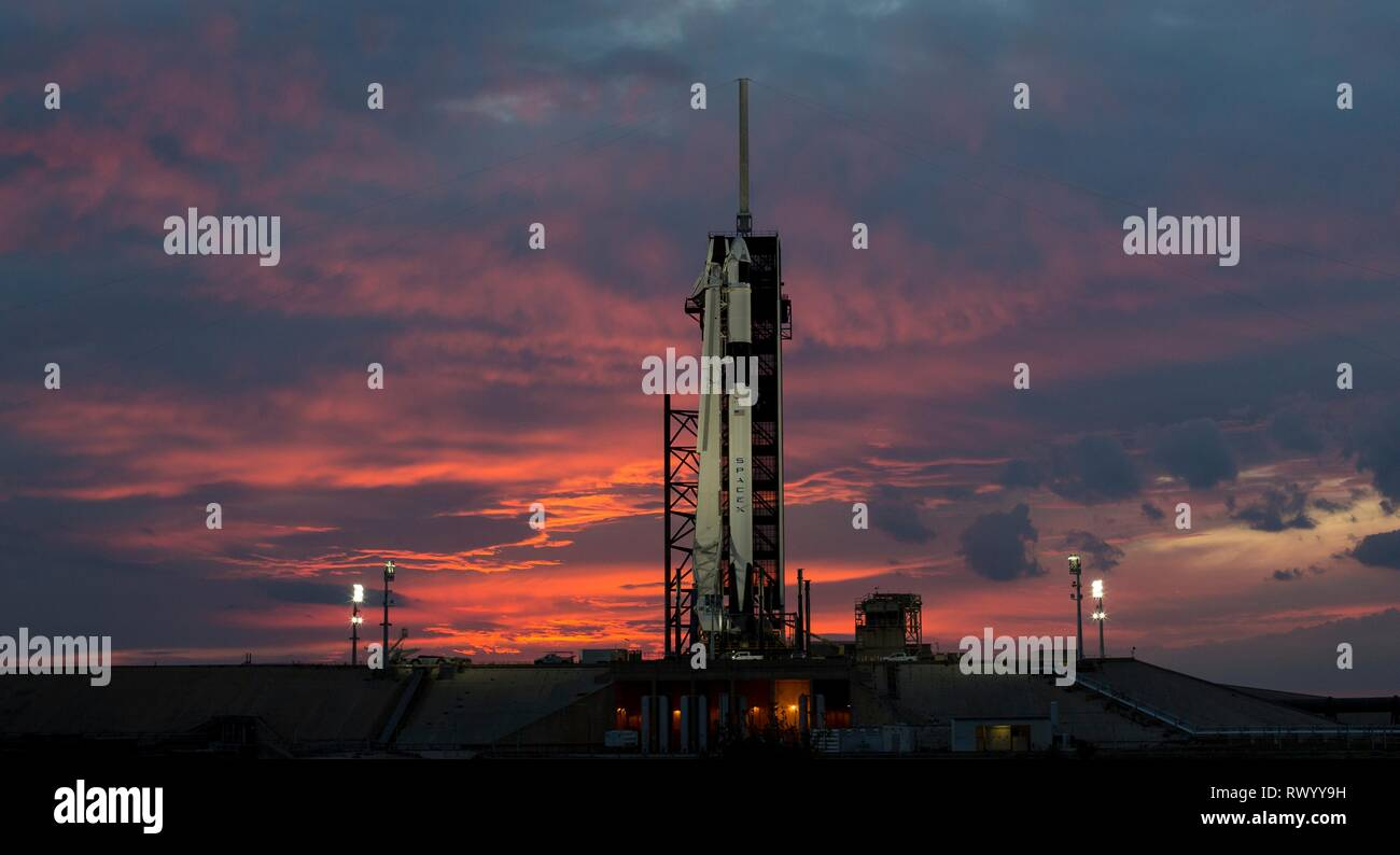 The SpaceX Crew Dragon spacecraft atop the Falcon 9 rocket during sunset at Launch Complex 39A ready the launch of the Demo-1 mission at the Kennedy Space Center March 1, 2019 in Cape Canaveral, Florida. - Stock Image