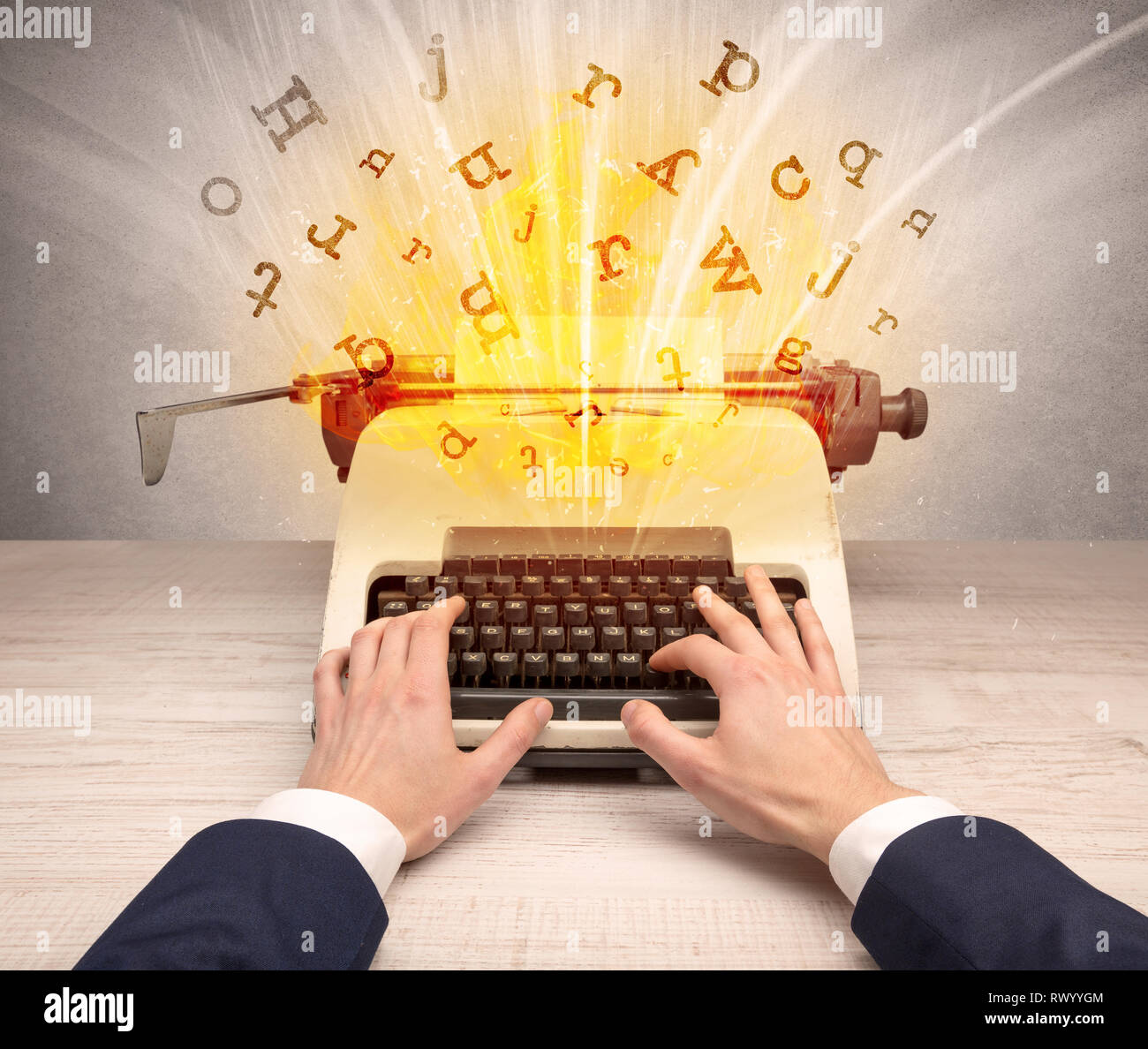 First person perspective image with exploding letters from a vintage typewriter concept  - Stock Image