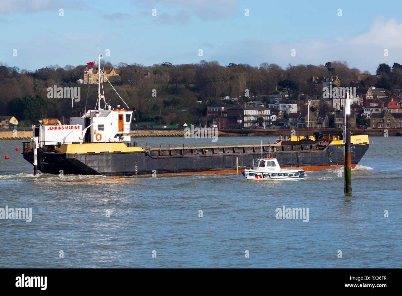 barge,ship,shipping,transport,sea, cargo, harbour,goods,harbour,master,boat,small,coaster,coastal,coast,timber,lumber, - Stock Image