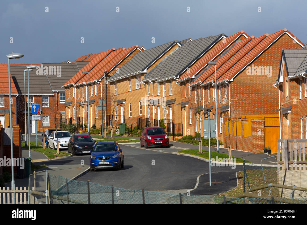 New,Build, green,belt,encroachment, terrace,street,road, timber,framed, low, Reducing, carbon emissions , carbon,footprint, energy, tile,tiled, field, - Stock Image