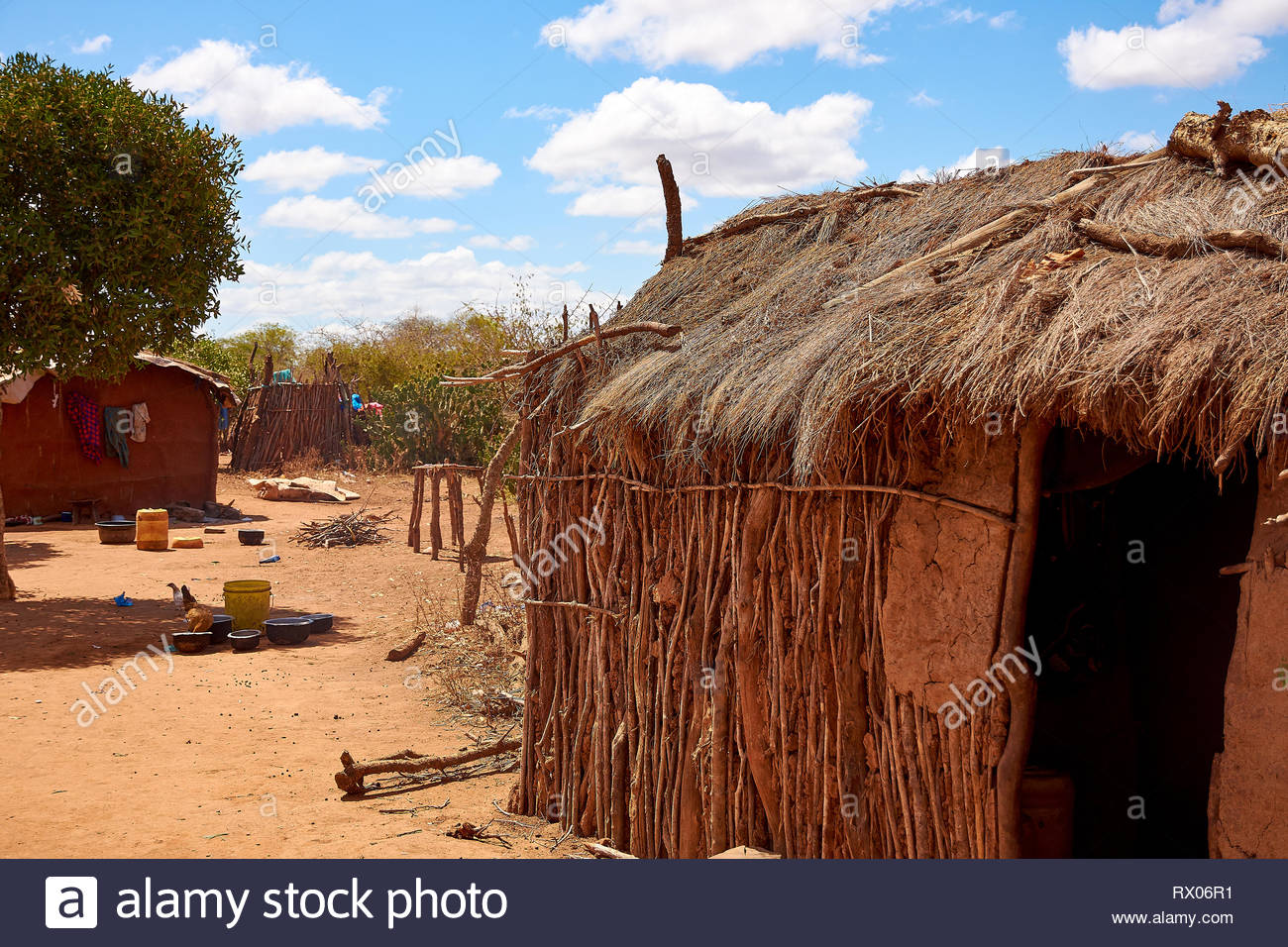 View of the Masai village with old clay huts. Poverty, misery and despair, living in Africa Stock Photo