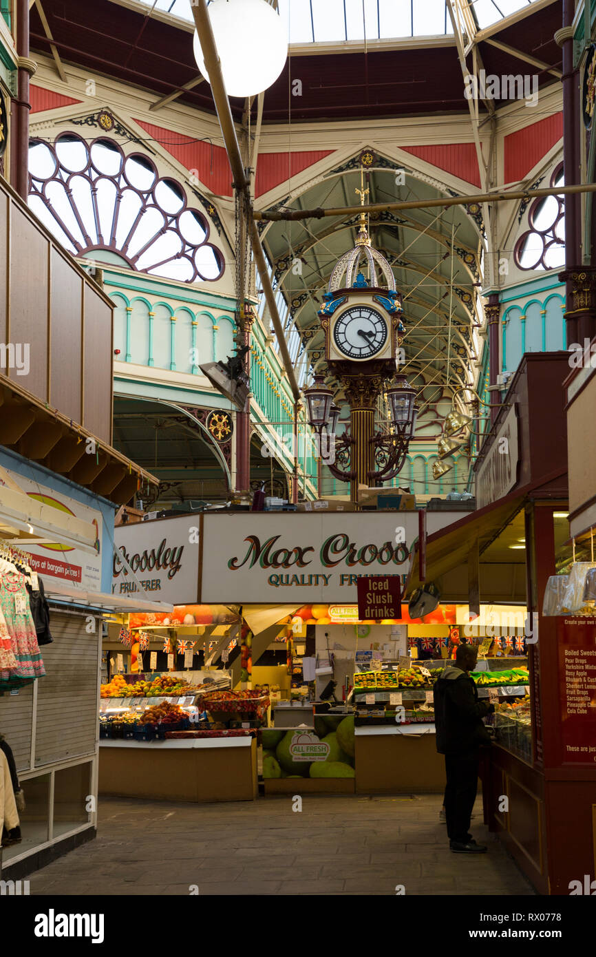 Central clock below the domed glass window and iron centre roof / ceiling  of Halifax indoor market, UK. (106) Stock Photo