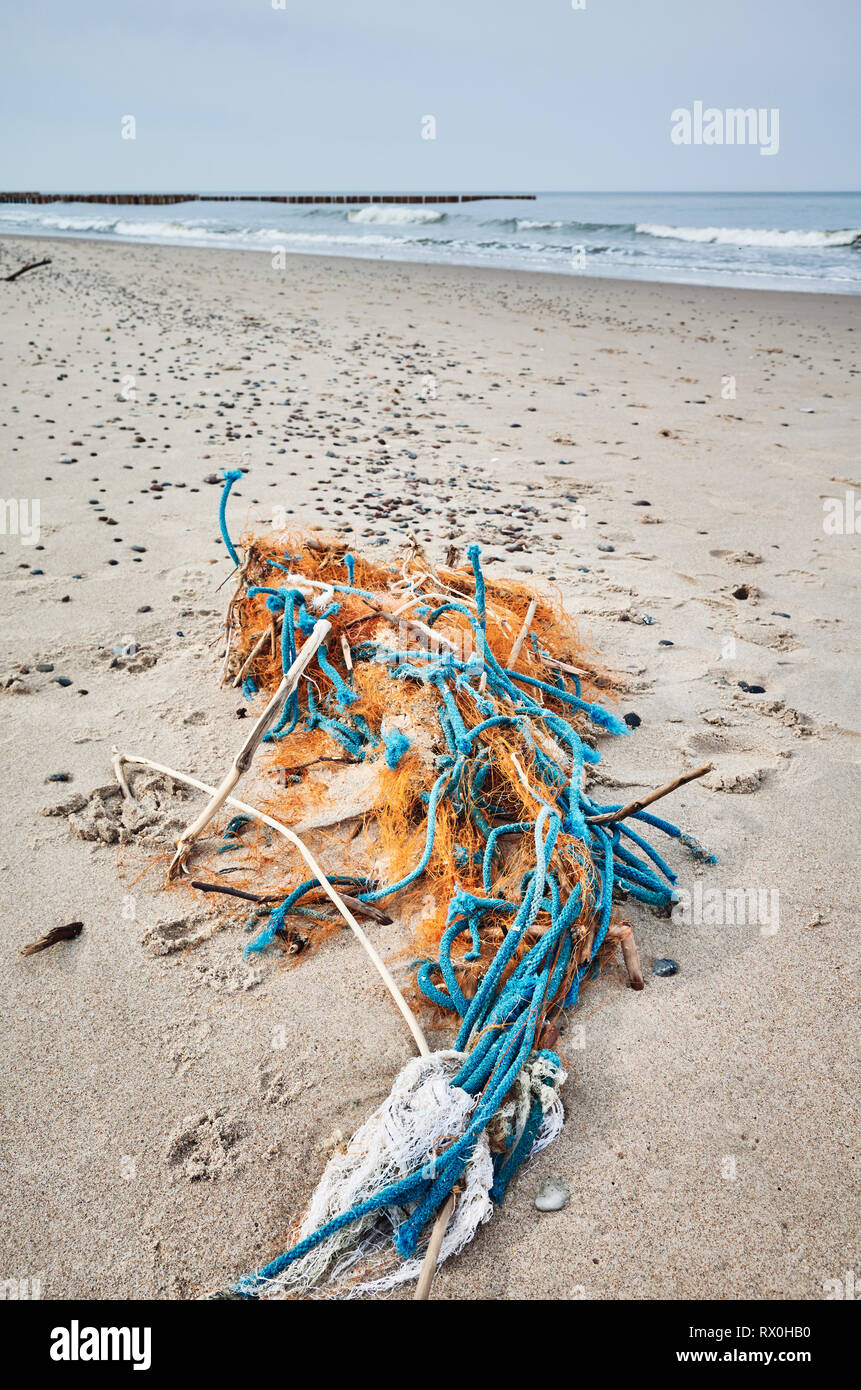 Plastic garbage on a beach, selective focus. - Stock Image